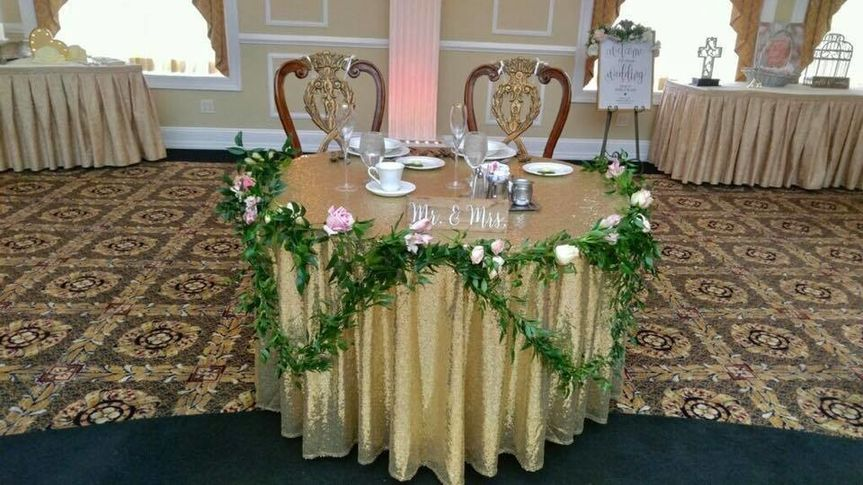 Floral garland on newlyweds' table