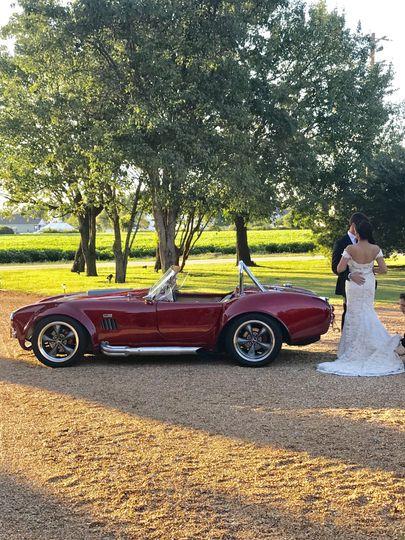 Newlyweds and their wedding car