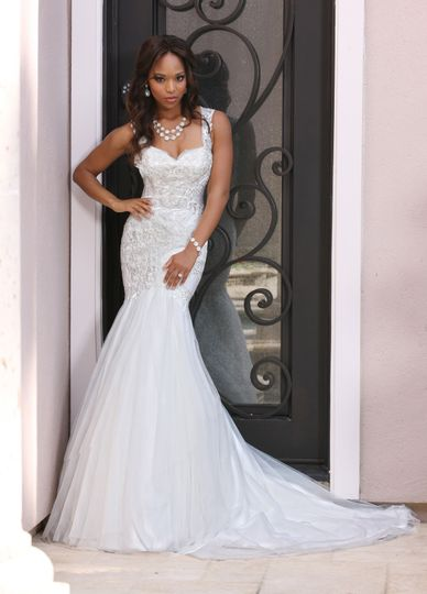 DaVinci Bridal Style #: 50373 Lace is scattered throughout this sweetheart neckline and straps which...