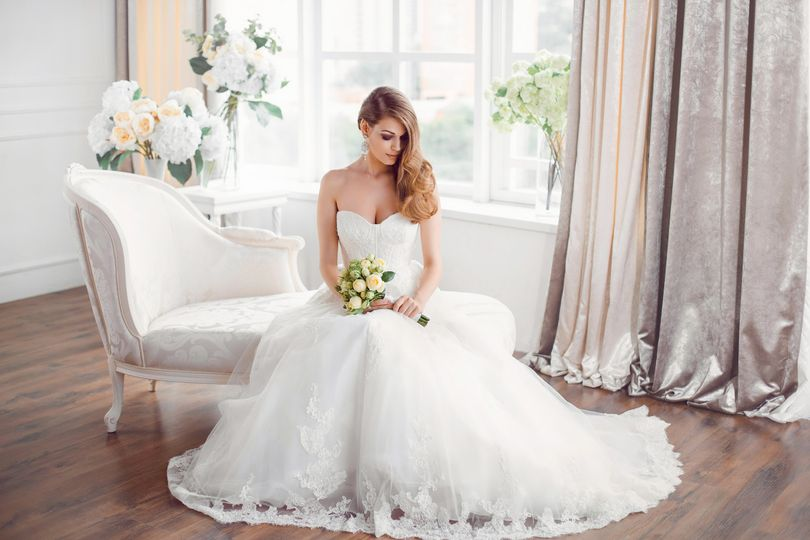 800x800 1512501186031 wedding. bride in beautiful dress sitting on sofa