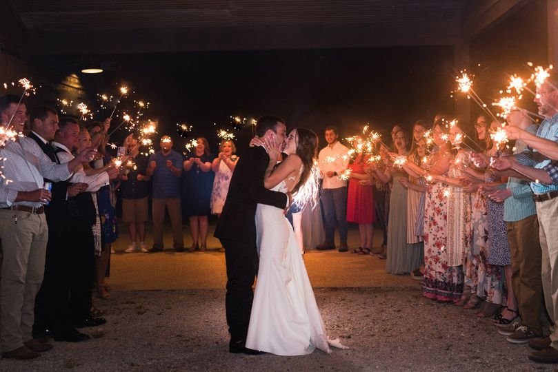 A kiss during their exit - Dee Ward Photography