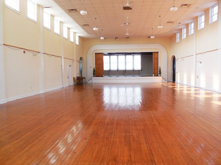 Historic Old Waldorf School Auditorium | Looking toward the stage with stage doors open