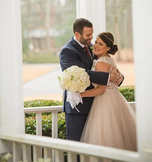The bride and groom on one of the many porch areas By Jerrod Brown Photography