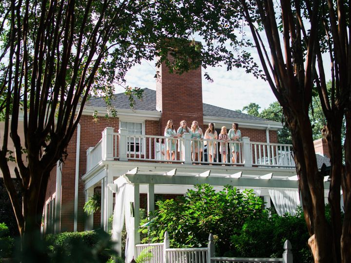 Bridesmaids enjoying some laughs on the balcony before getting dressed in the bridal suite. Photo...