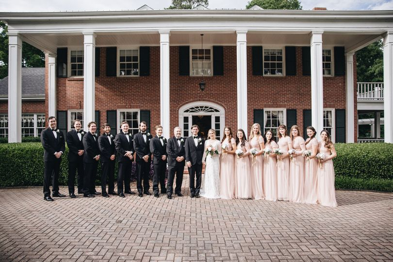 Bridal Party in front of the venue Photo by M. Fehr Photography