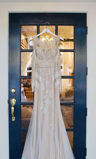 Ornate gown hanging on front door
