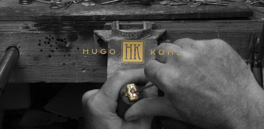 hugo hands at bench bw with logo