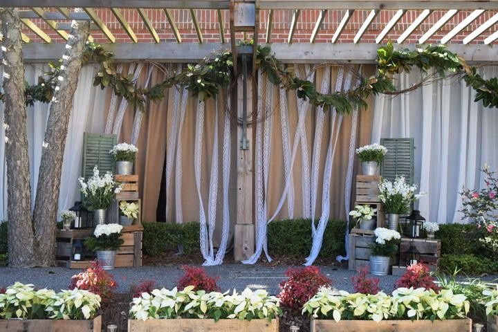 Outdoor Wedding Ceremony in Garden Courtyard at DoubleTree Suites by Hilton Charlotte SouthPark
