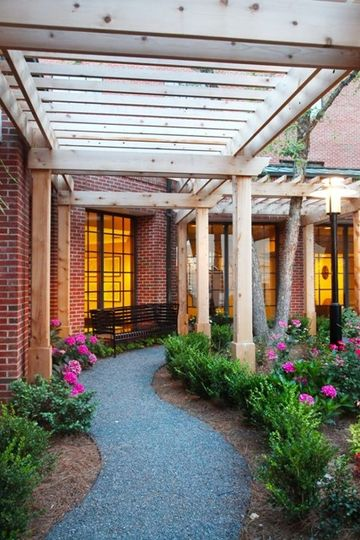 Pergola Covered Walkway leading to Garden Courtyard at DoubleTree Suites by Hilton Charlotte...