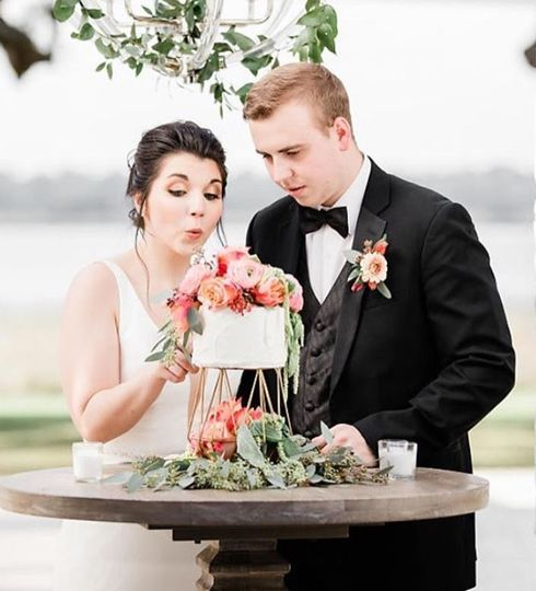 Newlyweds with their cake