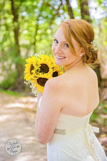 Bride with her sunflower bouquet