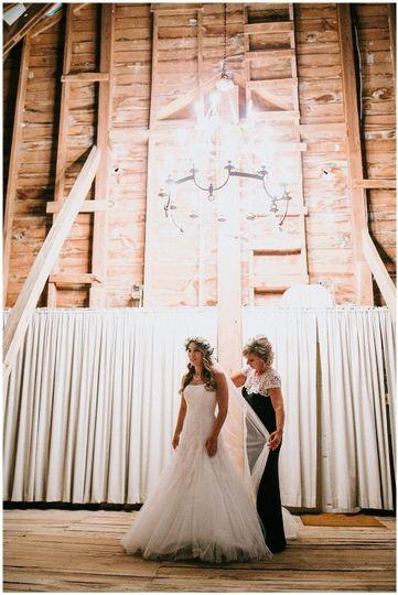 Bride's dress being prepared| Sarah Mosher Photography