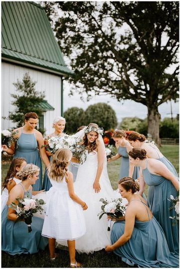 Bridesmaids helping the bride | Sarah Mosher Photography