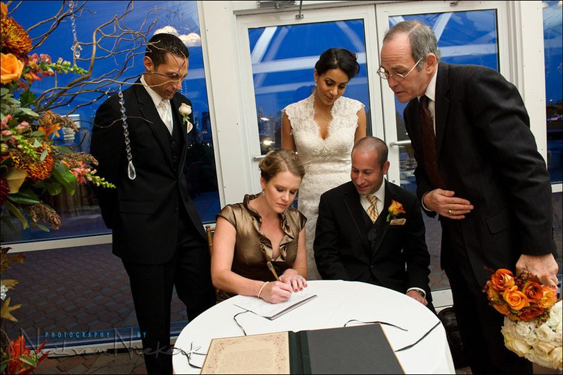Couple signing the marriage certificate