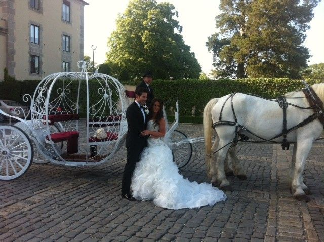 Couple by a carriage