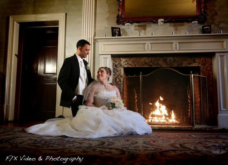 Newlyweds by the fireplace