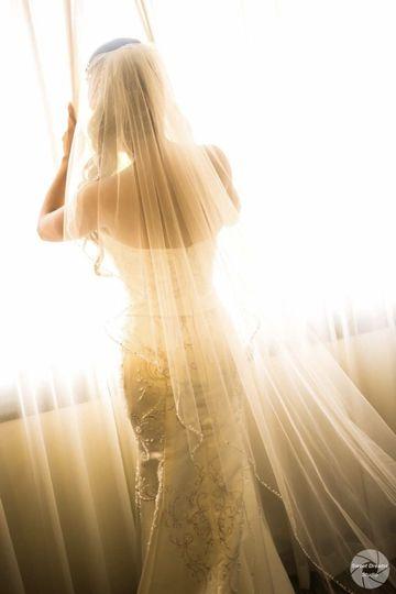 Bride against window