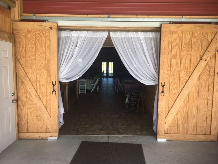 Barn door welcome into the barn hall