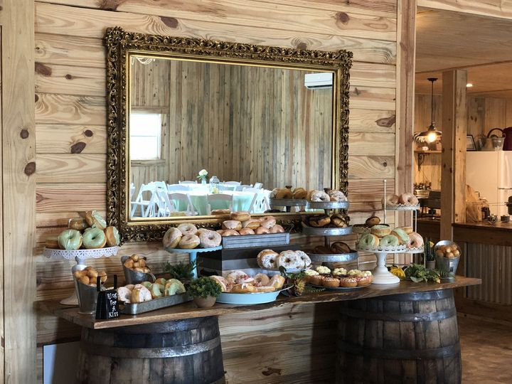 Whiskey barrels to hold couple's wedding cake or special dessert