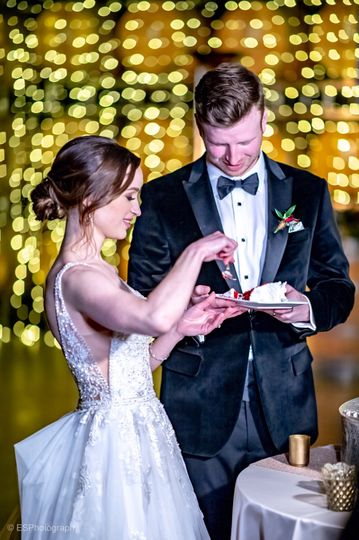 Enjoying a slice of wedding cake