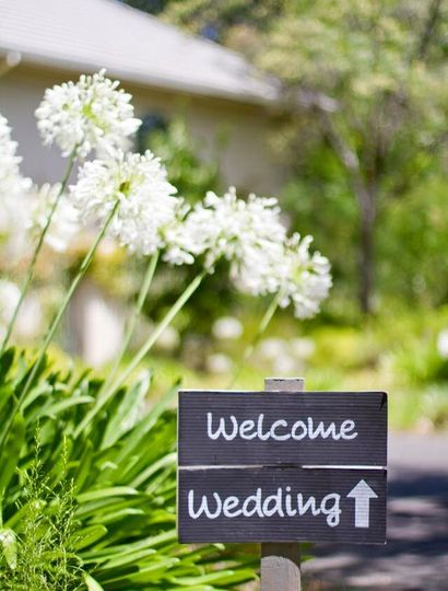 Entrance to the ceremony site. Location: Private winery in Napa, CA Theme: Rustic Colors: Green,...