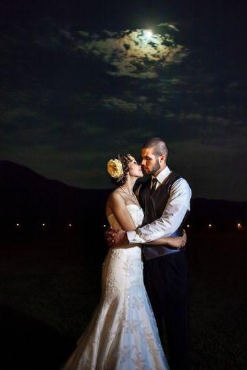 Lauren & Wes embracing under the moonlight after their wedding