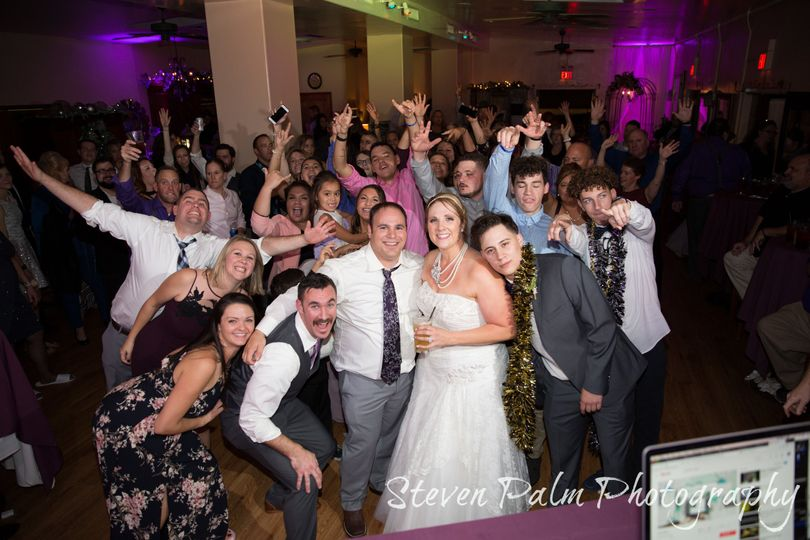 Packed dance floor with the newlyweds