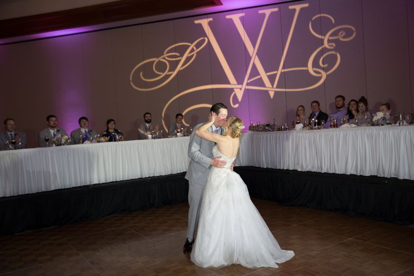 Ending their first dance with a kiss