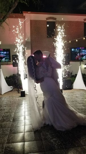 First dance & sparkler fountains in the background