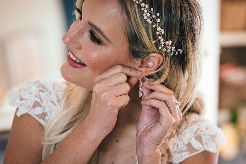 Putting on earrings
