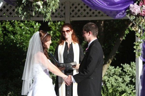 Look at the beautiful bride and groom.  Can you see the microphone?