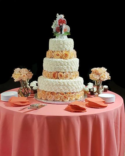 Tiered cake floating on roses