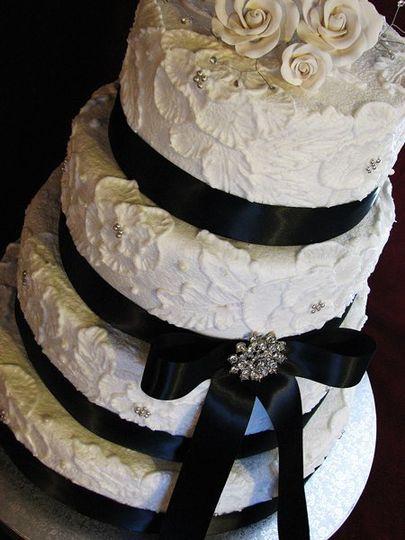 White wedding cake with black ribbon