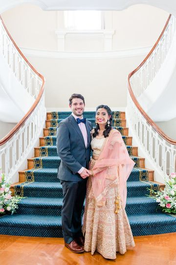 Newlyweds by the stairs