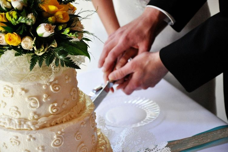 Cutting the cake - Captured Moments Photography