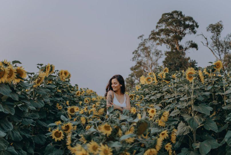Photographer in a sunflower field