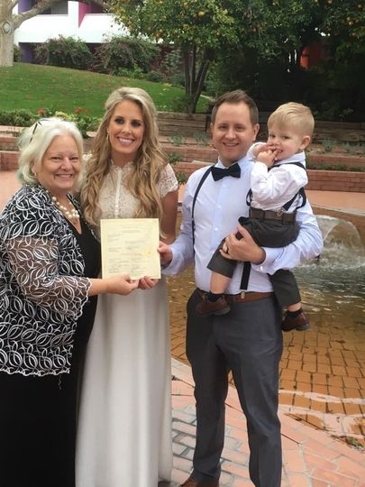 Family photo with officiant
