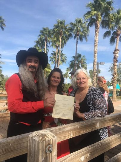 Newlyweds with officiant
