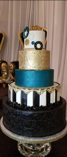 Black, blue, gold, and white cake