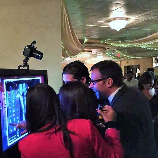 Guests huddled over the led screen