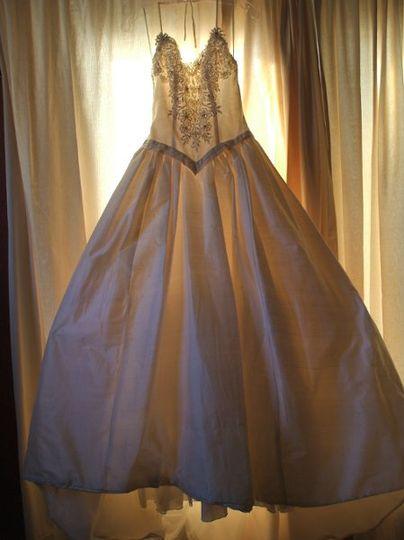 Gorgeous Ivory silk dupioni princess cut wedding gown...