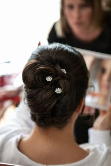 Elegant, clean, classic style with balanced volume and shape throughout updo.