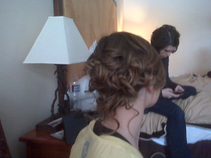 Not a professional photo, but a beautiful hairstyle nonetheless. On-location wedding venue in Vail.