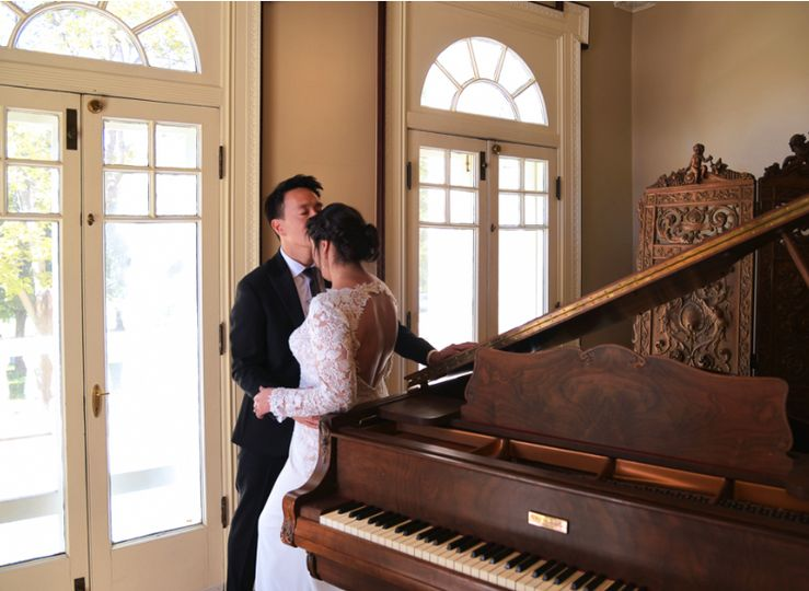 Kissing beside a grand piano