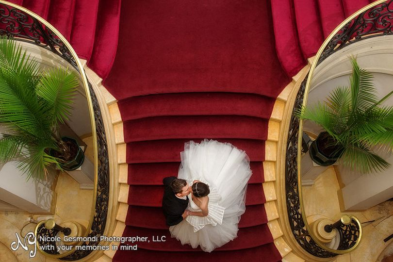 TJ & Margaux on the grand staircase at Rosecliff in