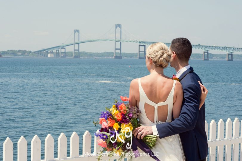 Newlyweds enjoying the view of the Newport Bridge immediately following their first look.