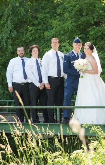 Newlyweds with the groomsmen