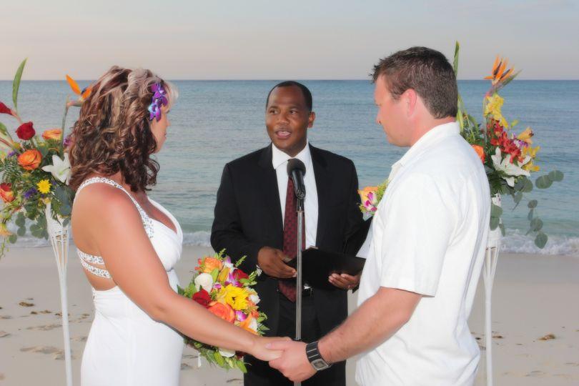 Beach wedding with tikki torch