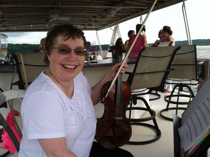 Violist Rochelle Naylor performs on a yacht for Orchestra Iowa's Sight and Sound auction.