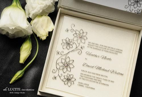 The modern Lucite wedding invitation is printed on plexiglas and accented with Swarovski crystals....